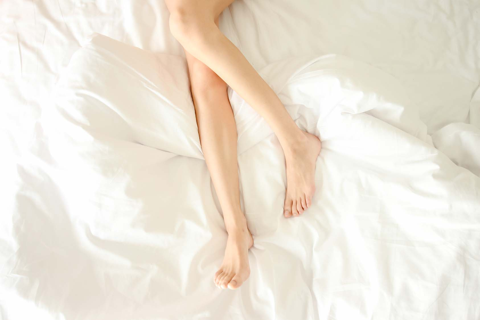 Beautiful female legs not covered top view void. Woman sticked h